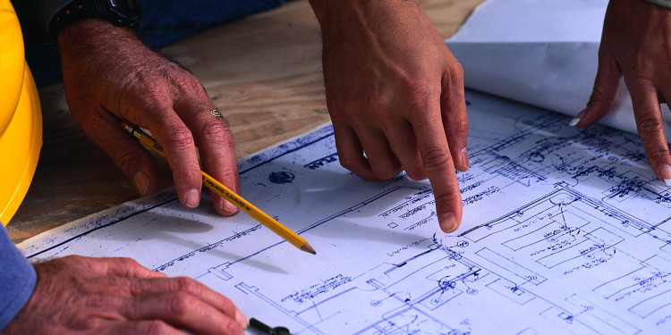 Hands Pointing at Blueprint